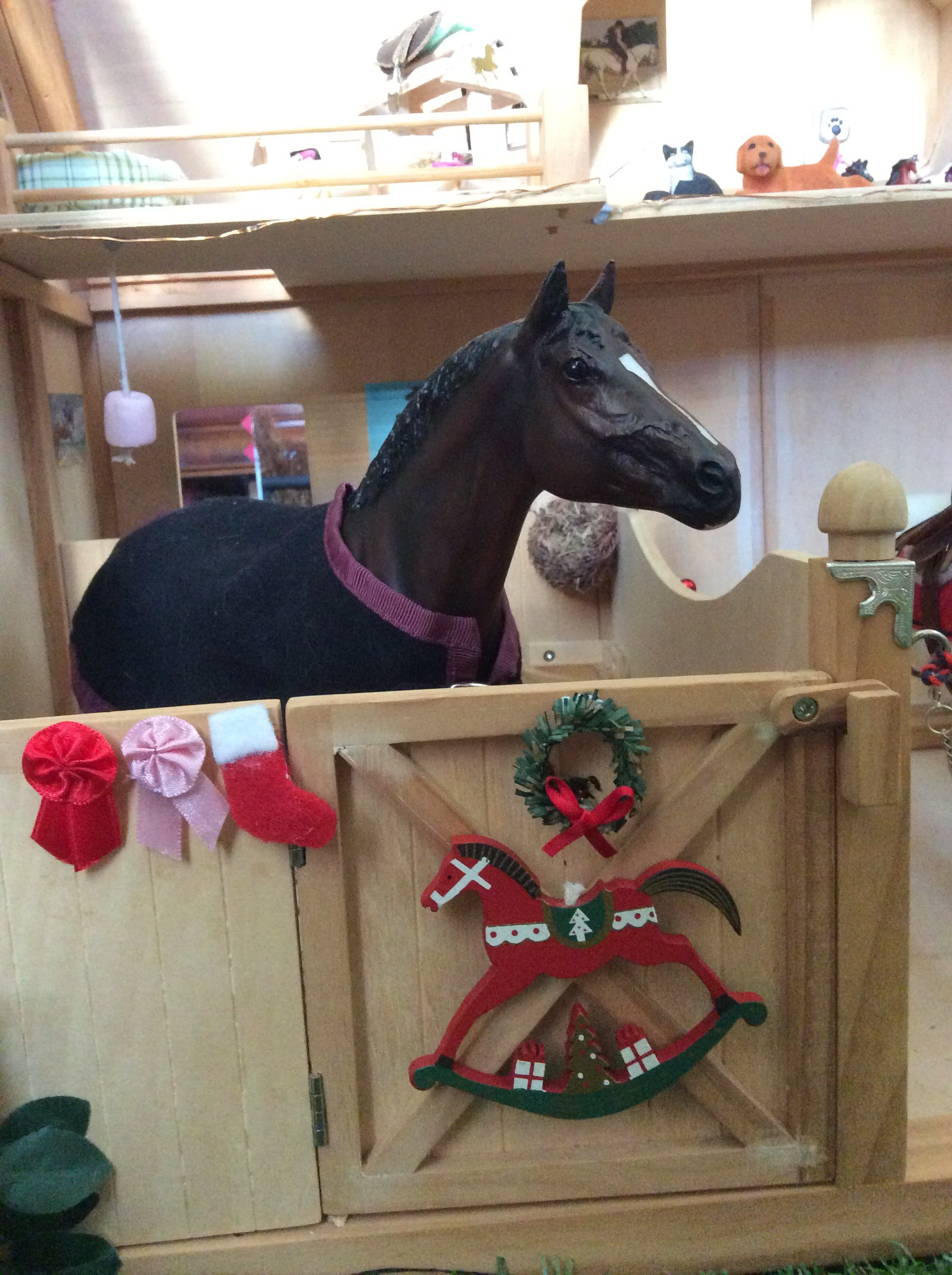 the main barn has lights red bauble string and a tree wapiti and hickstead both have stockings wreaths and a christmas rocking horse decoration